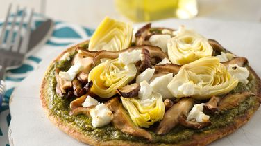 Pita Pizza with Arugula Pesto, Artichokes, Shitake Mushrooms and Goat Cheese