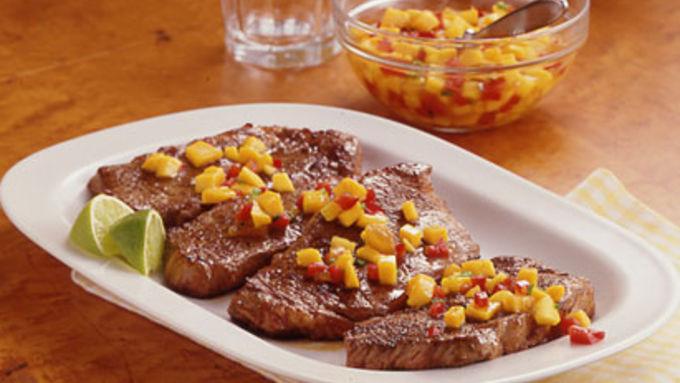 Strip Steaks with Mango-Peach Salsa