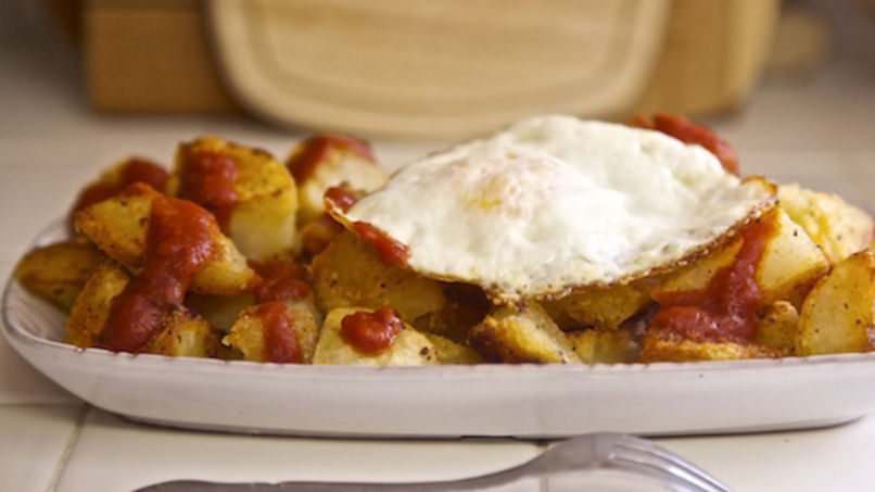 Patatas Bravas Topped with Fried Egg