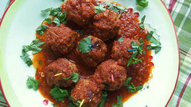 Cheese-Stuffed Pork Meatballs in a Chipotle Tomato Sauce