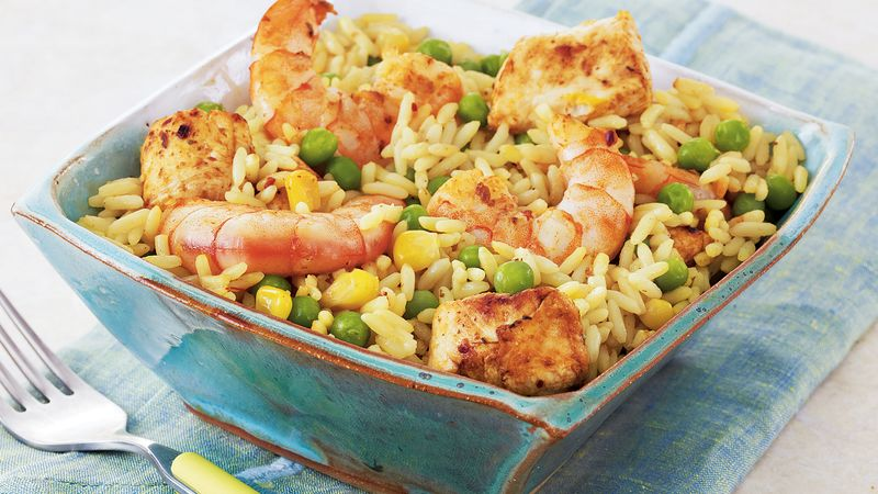 quick shrimp and chicken paella recipe from tablespoon. Black Bedroom Furniture Sets. Home Design Ideas