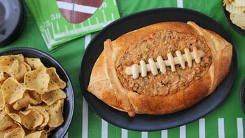 Taco Dip in a Football Bread Bowl