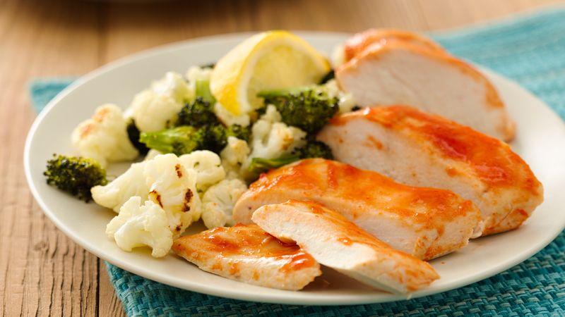 Healthy Sriracha Chicken with Roasted Broccoli and Cauliflower