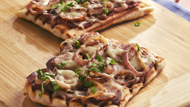 Grilled Kielbasa, Caramelized Onion and Basil Pizzas