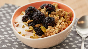 Peachy Berry Granola Yogurt Protein Bowl