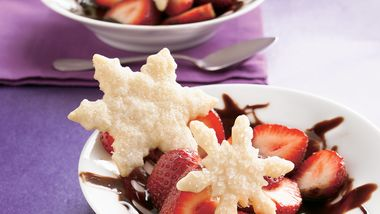 Strawberries in Chocolate with Pastry Snowflakes