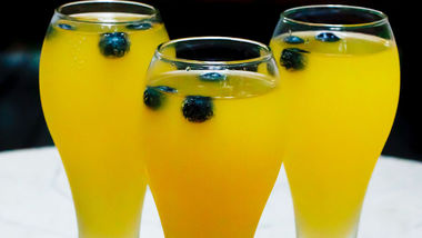 Mango-Blueberry Champagne Cocktail