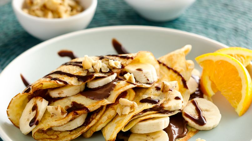 Crepes Filled with Banana, Hazelnut Cream and Nuts