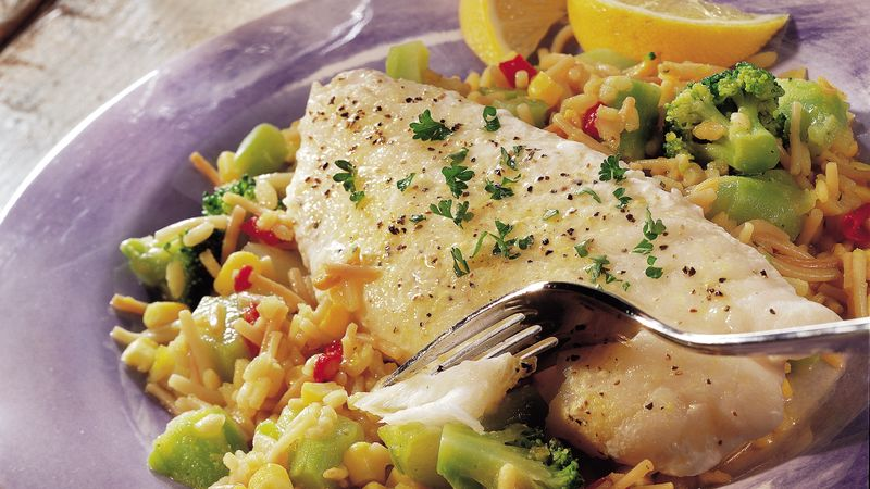 Lemony fish over vegetables and rice recipe from betty crocker for Rice recipes to go with fish