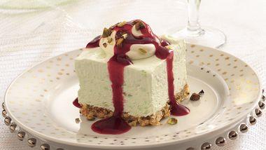 Frozen Pistachio Cream Dessert with Ruby Raspberry Sauce