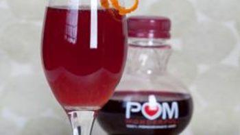 Pomegranate and Orange Champagne Cocktail
