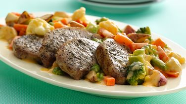 Roasted Pork Chops with Cheesy Vegetables