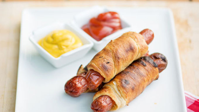 Hot Dogs Wrapped In Crescent Rolls Over Fire