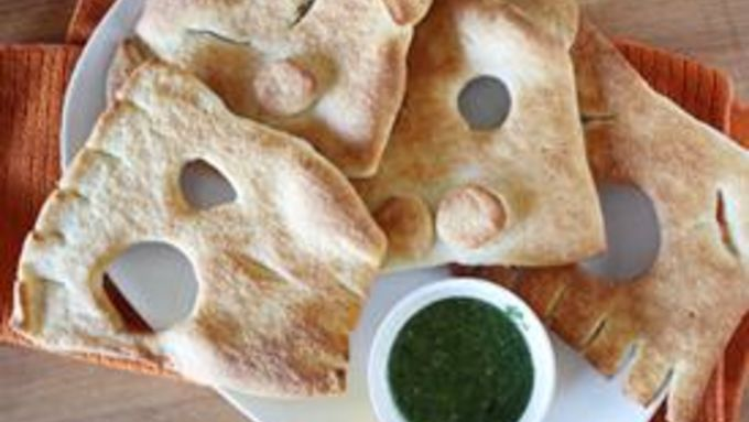 Ghoul Face Flatbreads with Goblin-Green Dipping Sauce