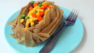 Potatoes Stuffed with Meat, Vegetables and Cheese