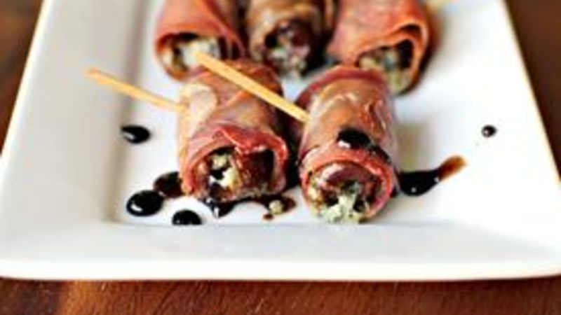 Prosciutto Wrapped, Gorgonzola Stuffed Dates in a Honey-Balsamic Drizzle