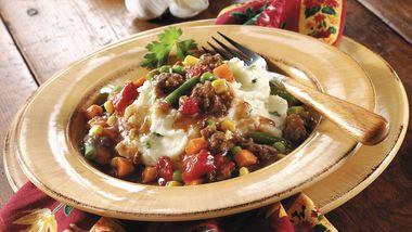 Ground Beef Stew over Garlic Mashed Potatoes