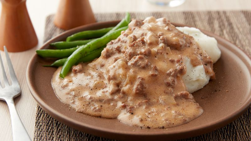 recipe: turkey in gravy over mashed potatoes [19]