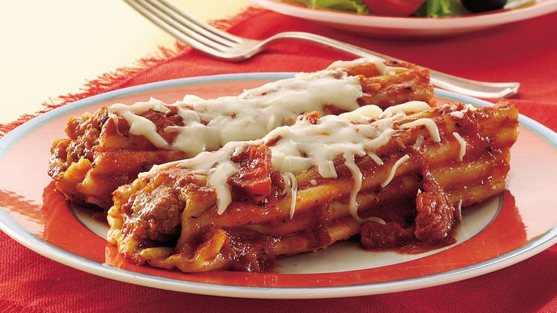 Shortcut Sausage-Stuffed Manicotti with Sun-Dried Tomato Sauce