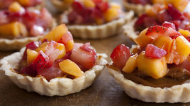 Rustic Tartlets Filled with Dulce de Leche, Strawberries and Mango