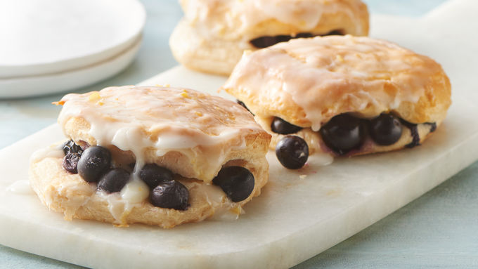 Quick easy biscuit dinner recipes and meal ideas pillsbury blueberry biscuits with sweet lemon glaze forumfinder Image collections