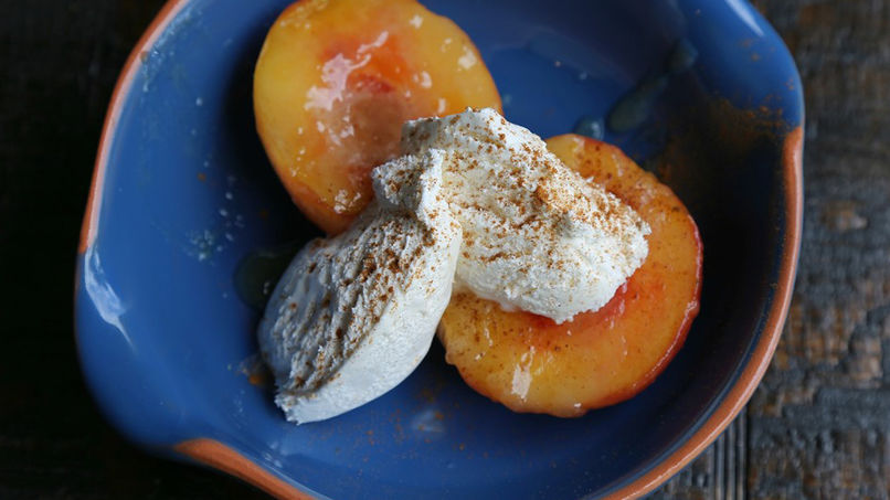 Cinnamon-Infused Baked Peaches with Cream