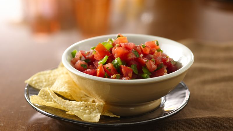 Bowl of homemade tomato salsa served with tortilla chips