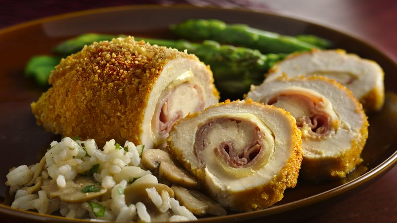 Chicken cordon bleu sliced and served on a plate