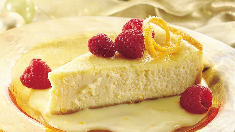 Luscious Orange Cheesecake with Raspberries