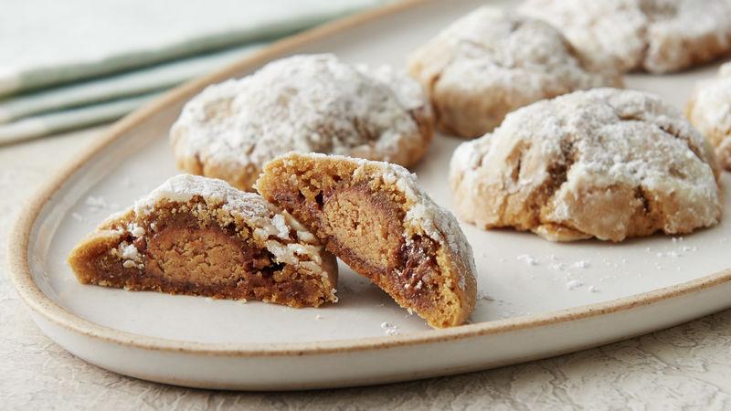 Peanut Butter Cup-Stuffed Snowball Cookies
