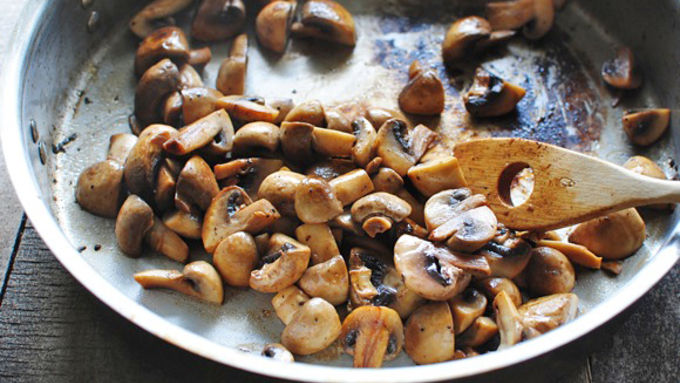 Mushrooms cooking in butter in saute pan