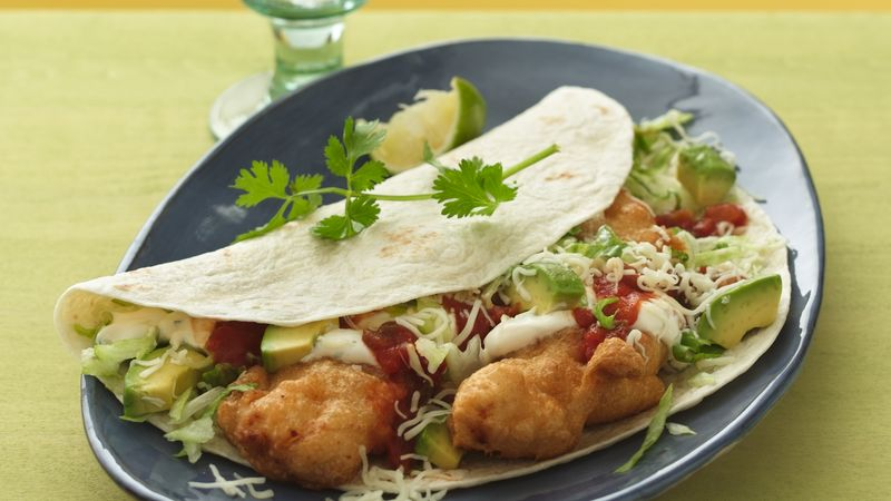 Crispy fish tacos with spicy sweet and sour sauce recipe for Sour cream sauce for fish tacos