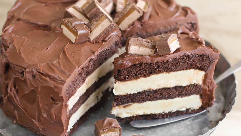 Layered Caramel Candy Bar Cheesecake
