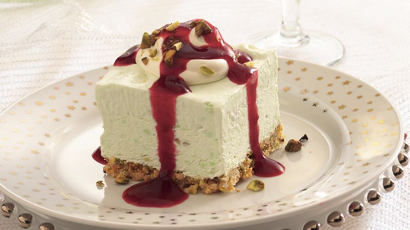 Frozen Pistachio Cream Dessert with Ruby Raspberry Sauce