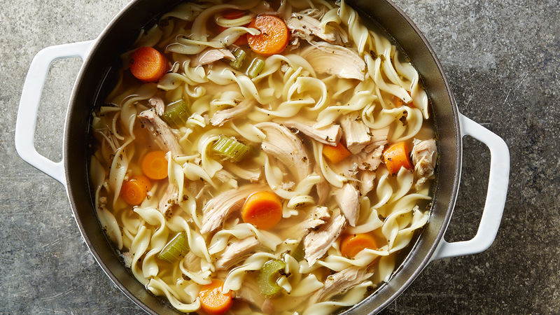 Homemade chicken noodle soup in Dutch oven