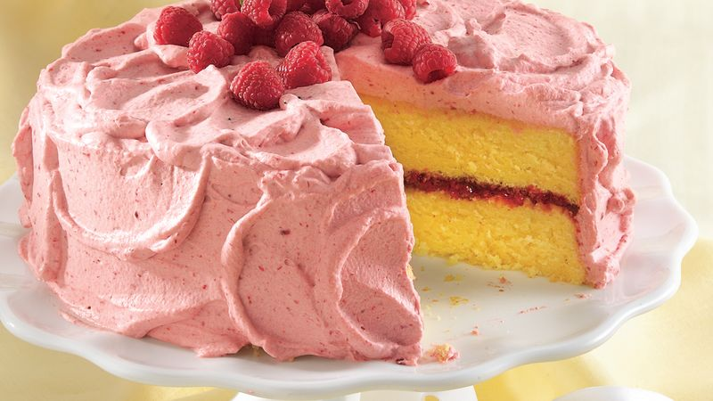 White Cake With Raspberry Filling And Whipped Cream Frosting