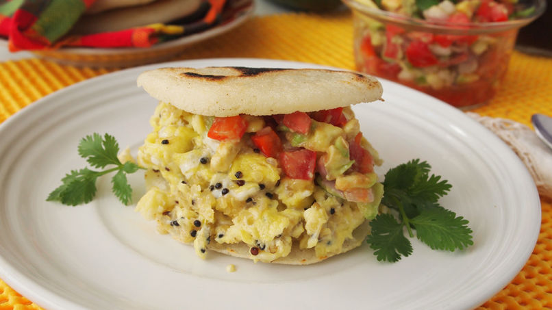 Arepas with Scrambled Eggs and Tomato and Onion Sauce