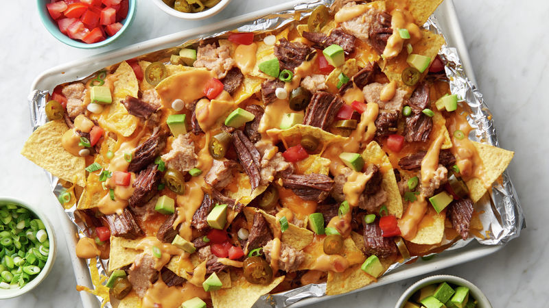 Slow Cooker Beef Barbacoa Nachos with Queso