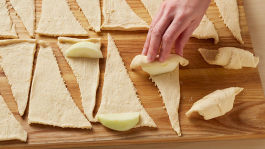 Apple slices on top of unrolled crescent triangles