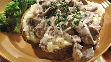 Slow-Cooked Beef Stroganoff Topped Potatoes