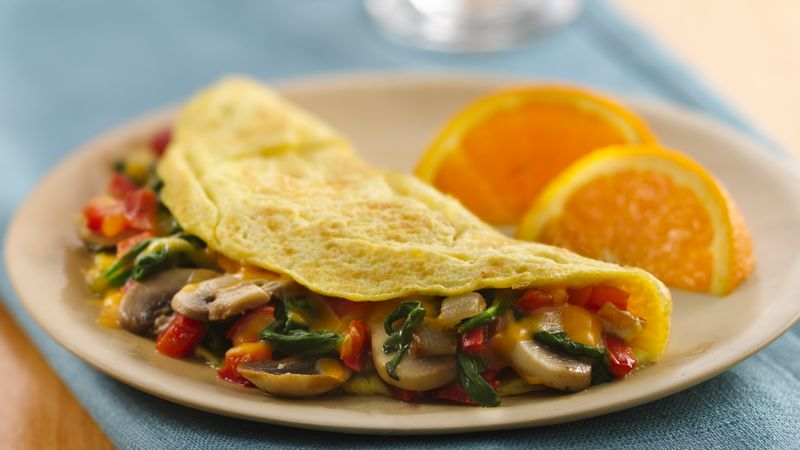 Veggie stuffed omelet recipe bettycrocker veggie stuffed omelet forumfinder Images