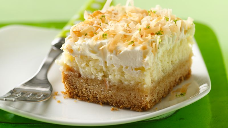 """Lime in the Coconut"" Frosted Cheesecake Bars"