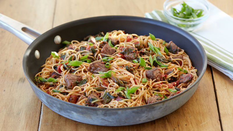 Stir-fried Steak and Tomatoes over Noodles