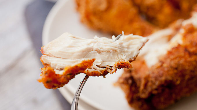 Piece of fried chicken on fork