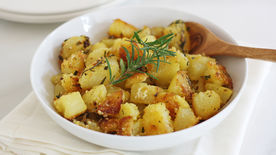 Polenta Crusted Roasted Potatoes with Herbs and Garlic