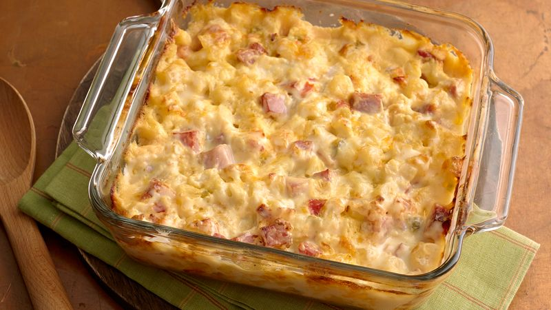 Baked creamy ham and potato casserole in a square baking dish.